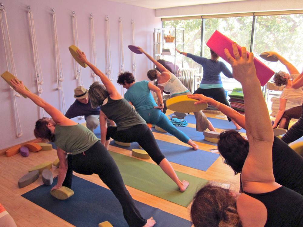 Yoga Class in Extended Side Angle Pose at Yoga Upstair Agoura Hills, CA